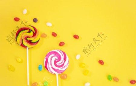 黄底棒棒糖果汁糖图片
